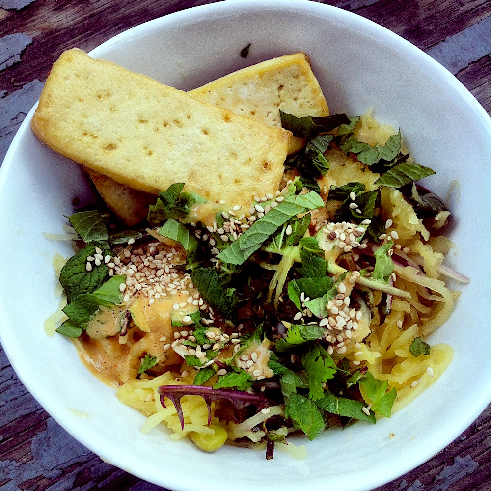Healthy, gluten free spaghetti squash noodle bowl with peanut lime sauce