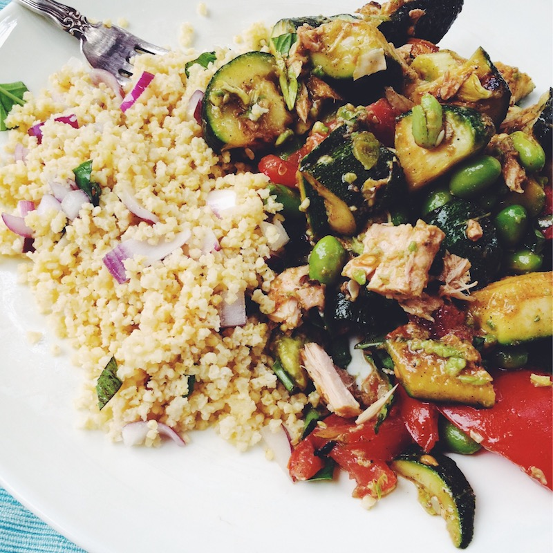 Summer version of salad nicoise with grilled zucchini, corn, fresh tomatoes