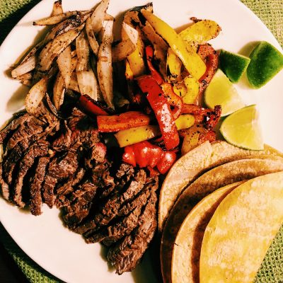 Best things about grilled steak fajitas? Grilled vegetables, marinated grass-fed beef, corn tortillas.