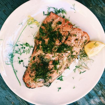 Wild-caught salmon simply grilled with dill, lemon, and butter