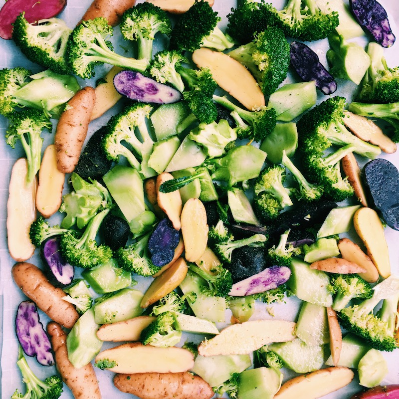 Fingerling potatoes and broccoli, rubbed with sesame oil and sea salt, ready for the oven