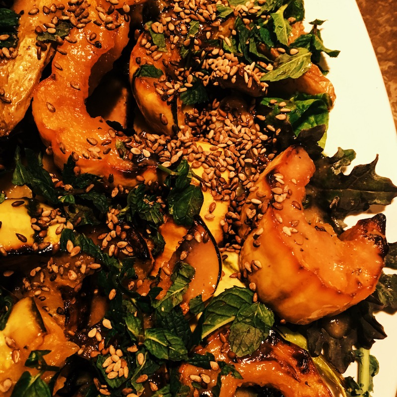 Close up of the delicata squash, finished with toasted sesame seeds and chopped mint