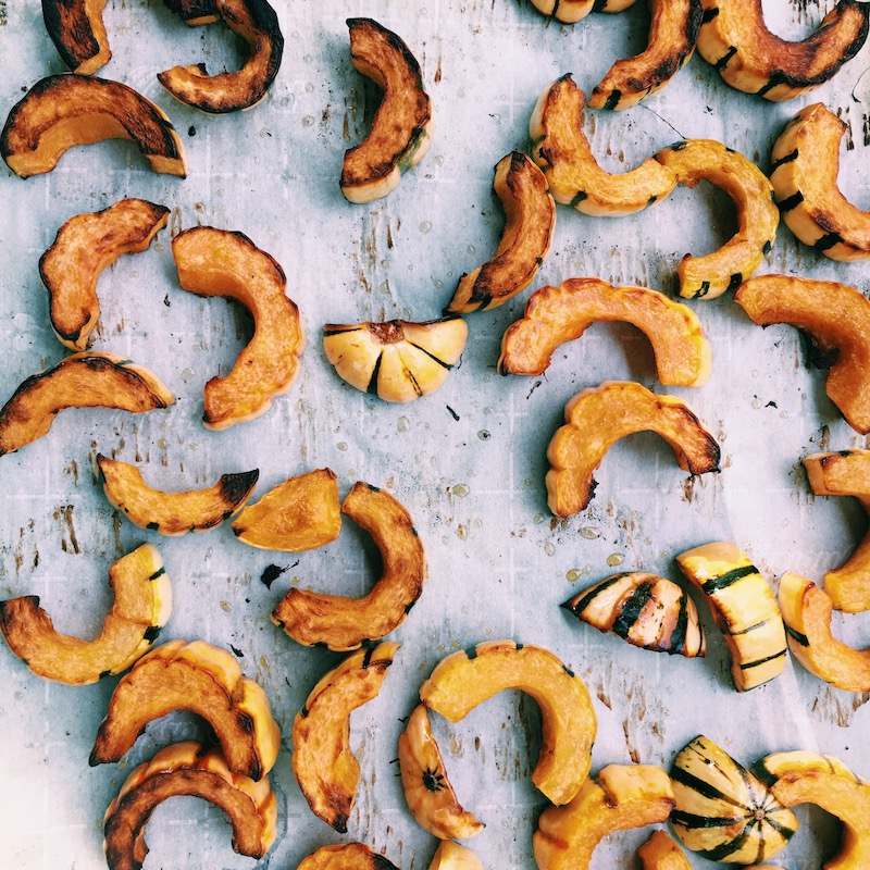 Delicata squash, just out of the oven, golden and ready for the glaze