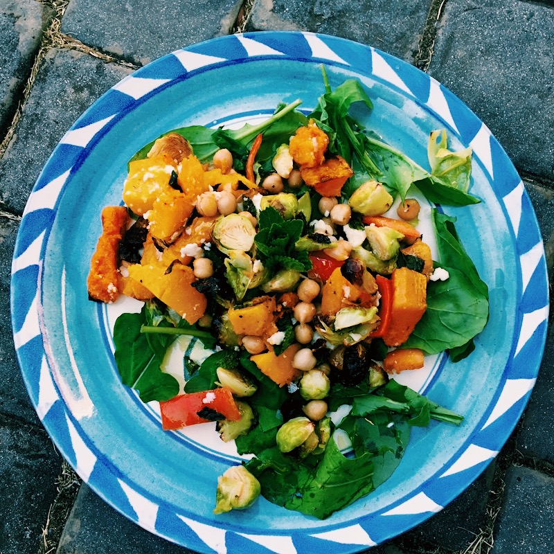 A bright, colorful butternut squash chickpea salad inspired by the flavors of Middle Eastern cuisine