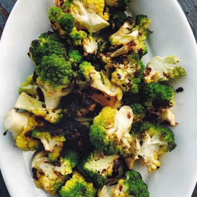 Romanesco tastes a bit like broccoli and cauliflower. Roasted romanesco, like most roasted vegetables, is delicious