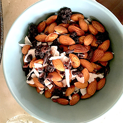 Homemade ageless trail mix with a few of our favorite things: coconut flakes, cacao nibs, and a little sweetness from the currants.