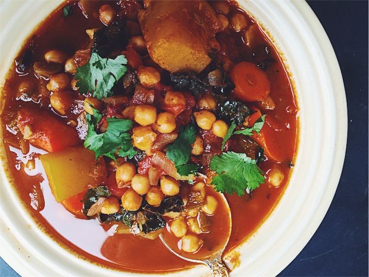 Sweet savory Moroccan winter vegetable stew with chickpeas, dates, butternut squash, and kale