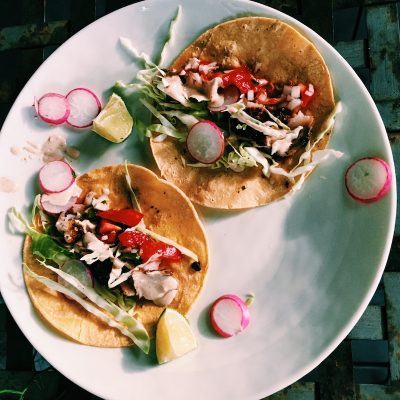 Classic baja fish tacos with cabbage, corn slaw, crema, and homemade pico de gallo
