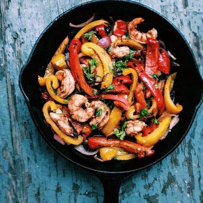 Shrimp fajitas, fresh bell peppers, tomatoes, corn, cilantro are an easy meal to throw together