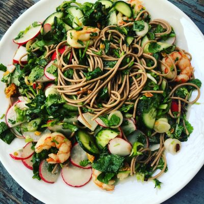 Fresh Herbs, Scallions, and Radishes with a Bright Chile Oil make this noodle salad a success